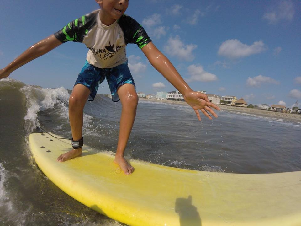 kid surfing in Charleston SC
